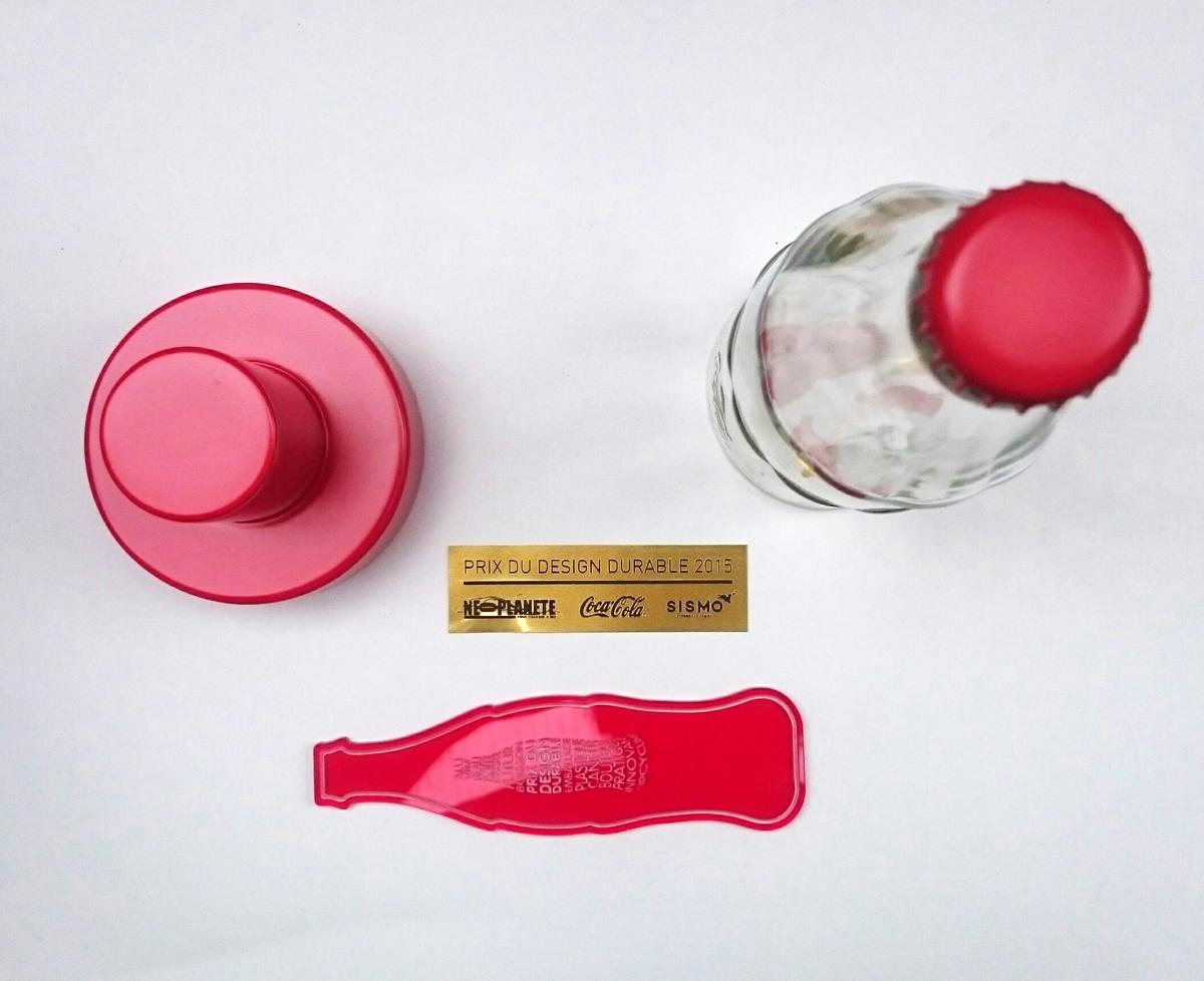 Trophee COCA COLA SISMO 2015 2 Avant montage Fabrication bouteille rouge chaise prix du design durable design sur-mesure Agence MAJOTIK